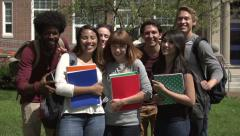 Racially-diverse students smile and embrace - slow motion. Stock Footage