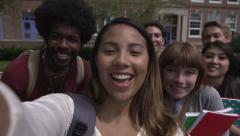 Racially-diverse students gather for a selfie - slow motion Stock Footage