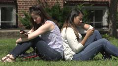 Caucasian and Hispanic female students use cell phones. - stock footage