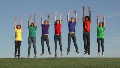 Multiracial group of 7 young people jumping up, slow motion Stock Footage