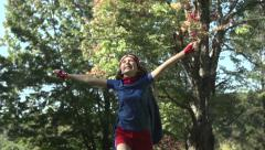 A superhero girl runs with arms aloft in slow motion - stock footage