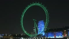The London Eye, a giant Ferris wheel on the South Bank of the River Thames Stock Footage