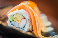 Salmon sushi roll maki Stock Photos