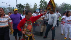 Buddhism pilgrimage procession on road Stock Footage
