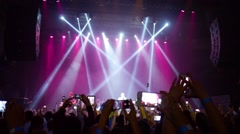 Fans with mobile phones in hands filming a rock concert show. - stock footage