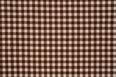 Brown and white gingham cloth background Stock Photos