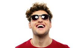 laughing man with curly hair and sunglasses on a white backgorund - stock photo