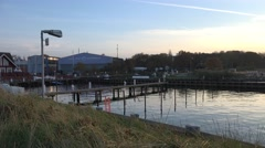 4k Sunset pan Timmendorfer Strand harbor at end of day Stock Footage