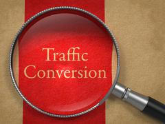 Traffic Conversion through Magnifying Glass. Stock Illustration
