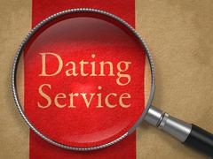 Dating Service through Magnifying Glass. Stock Illustration