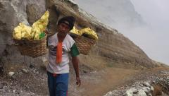 Sulfur Miner Working at Kawah Ijen Volcano, East Java, Indonesia Stock Footage