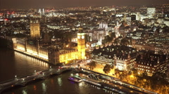 Houses of Parliament and Big Ben aerial view by night Stock Footage