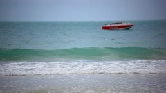 Red boat on a beach. Sea waves during cloudy weather. HD. 1920x1080 Stock Footage