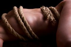naked female body is bounded - stock photo