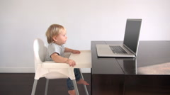 blonde baby watching pc - stock footage