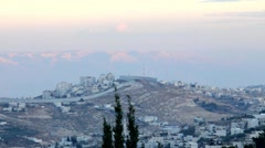 Security fence separating Jerusalem and its eastern suburbs at the evening Stock Footage