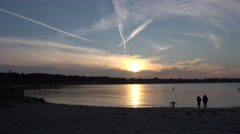 4k Family walk and enjoy relaxing sunset at beach Timmendorfer Strand Stock Footage