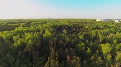 Large park with houses among trees at sunny spring day Stock Footage