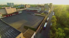 Cityscape with trucks parked on road near meat packing plant Stock Footage