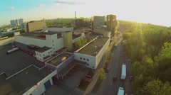 Cityscape with cars ride by road near meat-packing factory Stock Footage