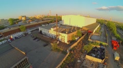 Cityscape with industrial zone at spring evening during sunset Stock Footage