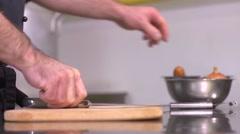 The restaurant of Ukrainian cuisine chef prepares vareniks - peel the onion Stock Footage