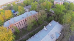 Old houses in style of constructivism at spring evening Stock Footage