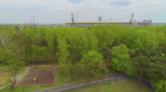 Locomotive sports arena against townscape at spring day Stock Footage