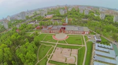 Park with playgrounds near Palace of Children and Youth on shore Stock Footage