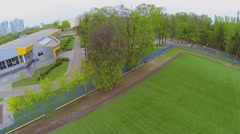 Rugby field in city park at spring day. Aerial view Stock Footage
