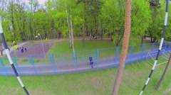 Gate on field for rugby in park with people at spring day. Aerial view Stock Footage