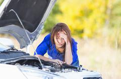 Girl with a broken car Stock Photos