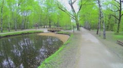 Small bridge over Putyaevsky pond at spring day in park Stock Footage