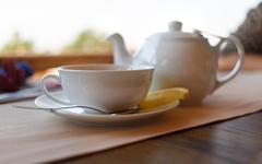 Tea with lemon and tea maker Stock Photos