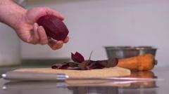 The restaurant of Ukrainian cuisine chef prepares vareniks - cuts the beet Stock Footage