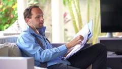 Businessman having a telephone conversation with  while reading documents HD. Stock Footage