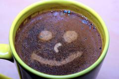 Smiling coffee Stock Photos