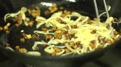 Ukrainian cuisine restaurant chef fries bacon and onions for vareniks Stock Footage