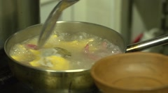 Ukrainian cuisine restaurant chef gets ready vareniks from the water Stock Footage