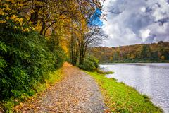 Autumn color and trail at the trout lake in moses h. cone park, on the blue r Stock Photos