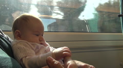 Little baby on train with mom Stock Footage