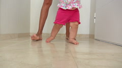 mom and baby walking indoor - stock footage