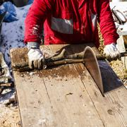 Man working with circular saw blade - stock photo