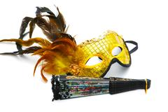 Masquerade  mask and  fan isolated on a white background Stock Photos