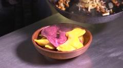 Ukrainian cuisine restaurant chef sprinkles vareniks bacon and onions Stock Footage