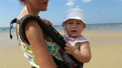 Mother carrying baby in rucksack Stock Footage