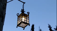 Old lantern on a stone wall Stock Footage