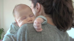 Mother cradling baby Stock Footage