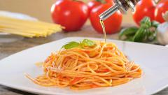 pouring olive oil over spaghetti - stock footage