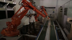 Two industrial mechanical arms working. Stock Footage